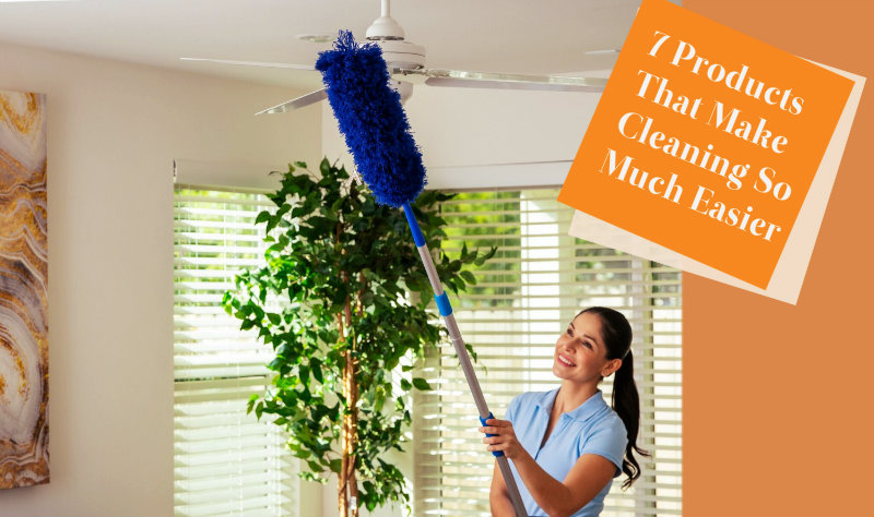 happy young woman using long handle brush to remove dirt from fan