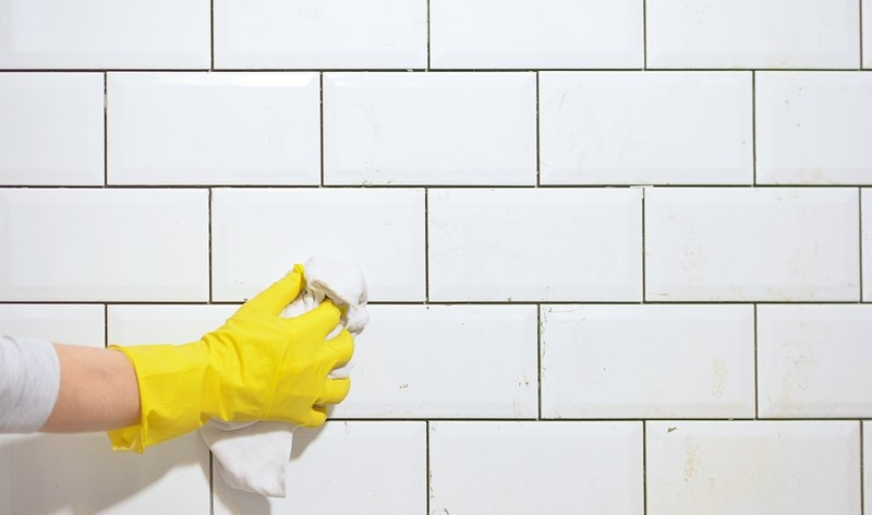 wiping tiles with a cloth